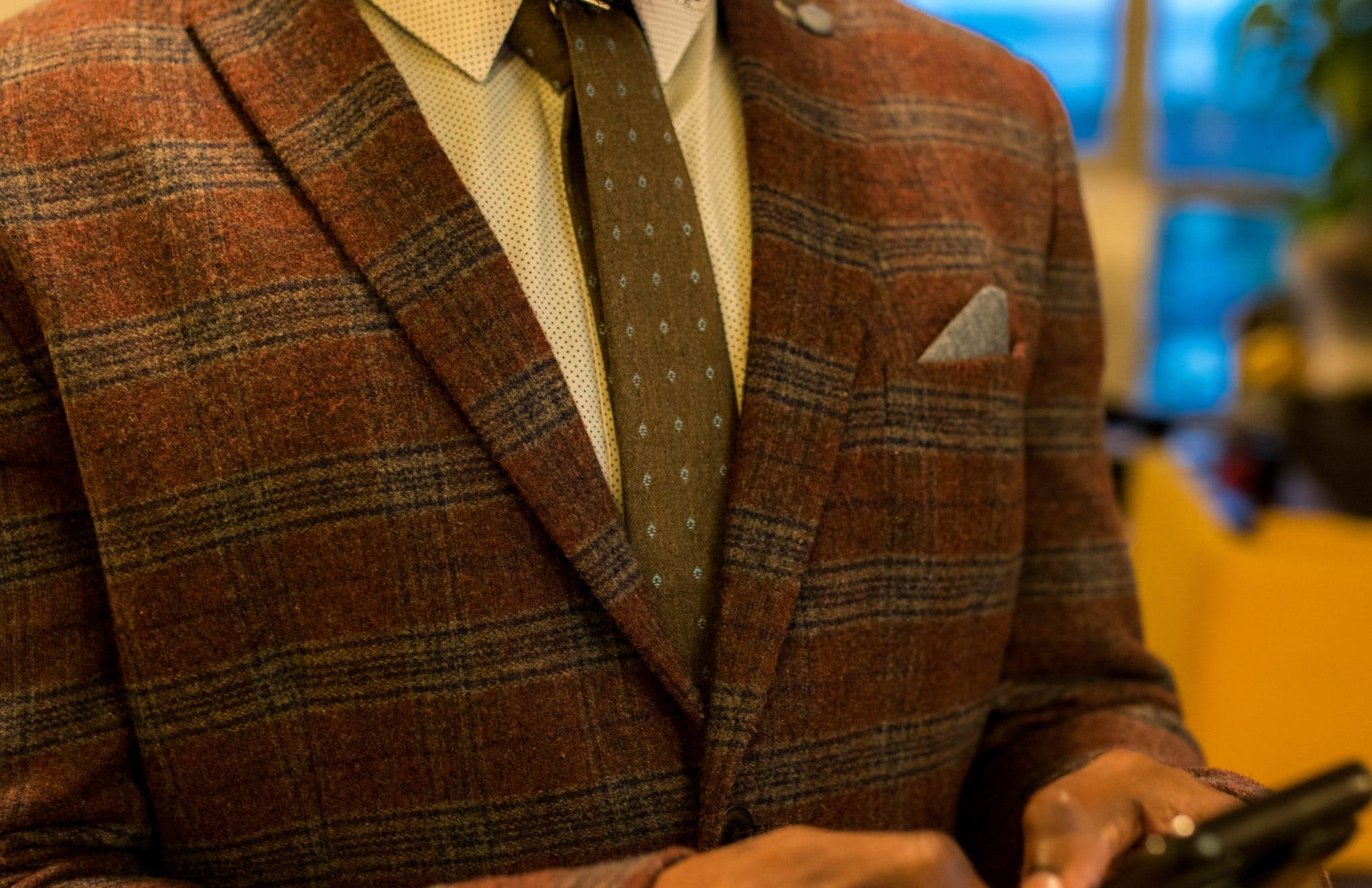 Person Wearing Red and Gray Plaid Suit Jacket