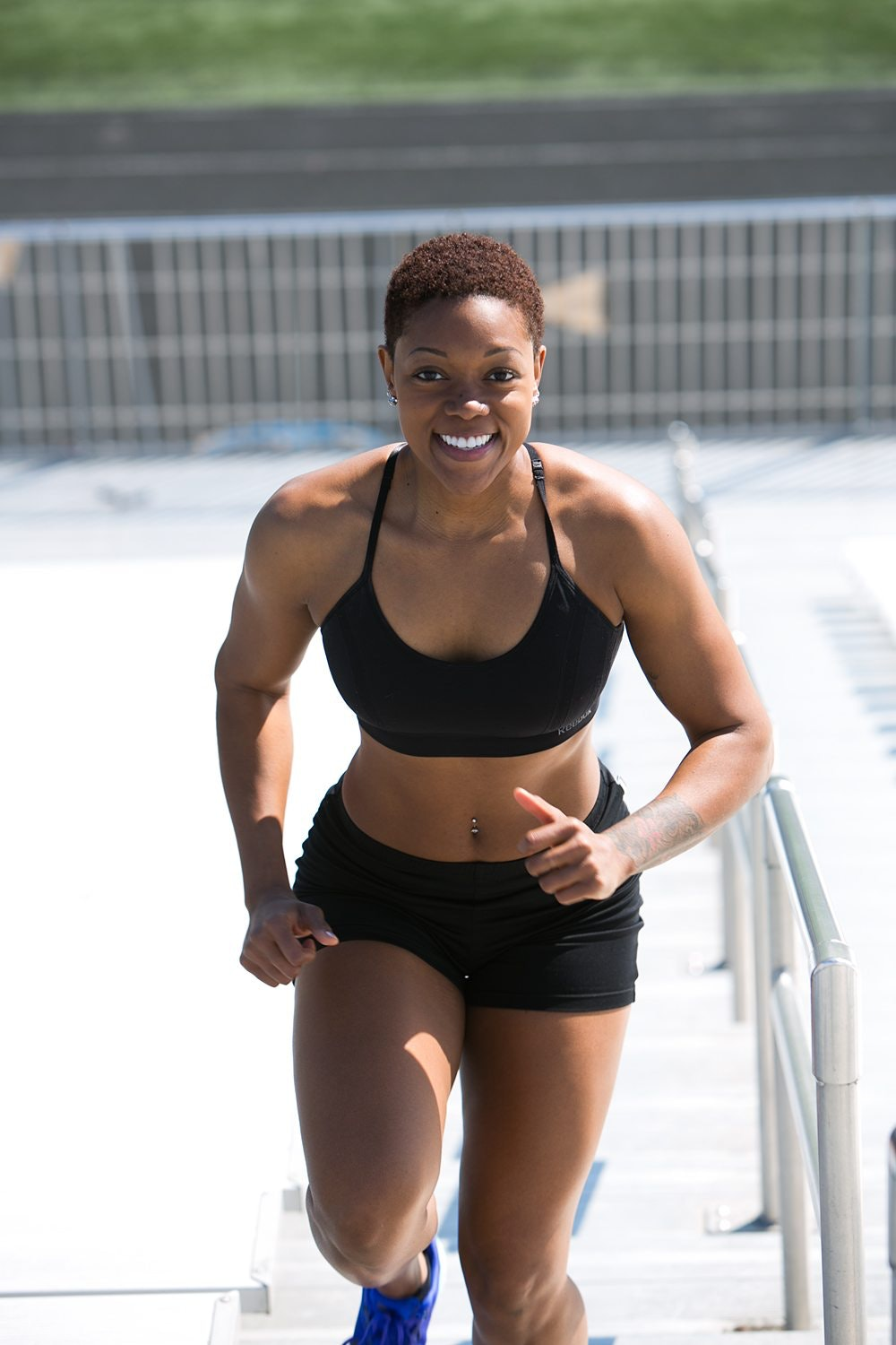 Woman Wearing Black Sports Bra And Jogger Shorts Smiling Free Sport Butterfly Download