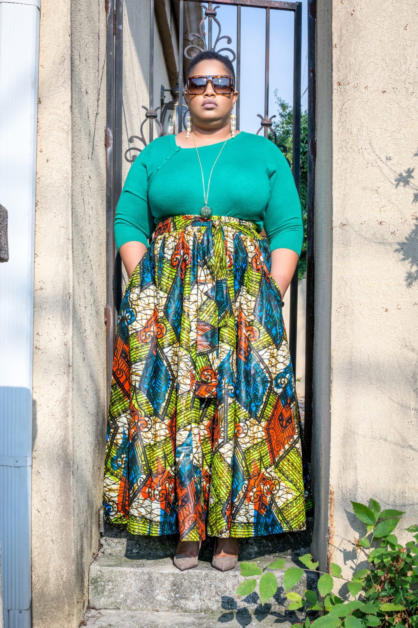 Woman Wearing Green Long-sleeved Shirt and Printed Skirt