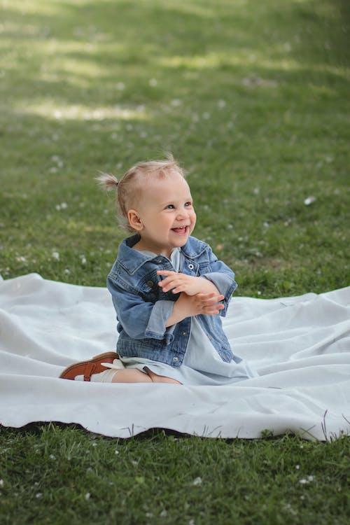 Photo of a Cute Kid in a Denim Jacket