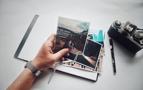 Person Holding Photo Near Camera