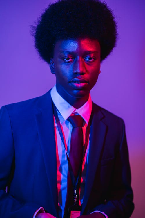 A Man with an Afro in a Suit