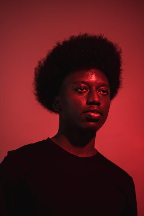 Kostenloses Stock Foto zu afro, beleuchtet, einfarbig