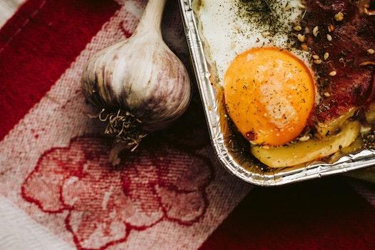 Close-up Photography of Garlic and Egg Yolk