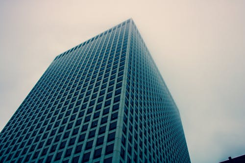 Low Angle Photography of Blue Building