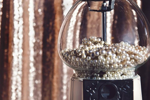 Close-up Photography of Clear Glass Candy Dispenser