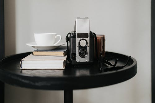 Black and Silver Camera on Black Wooden Table