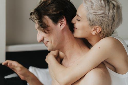 Woman Kissing Man's Nape