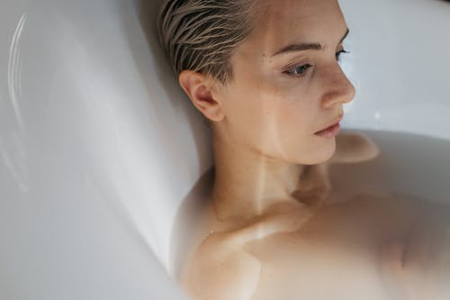 Woman in a Bathtub With Water