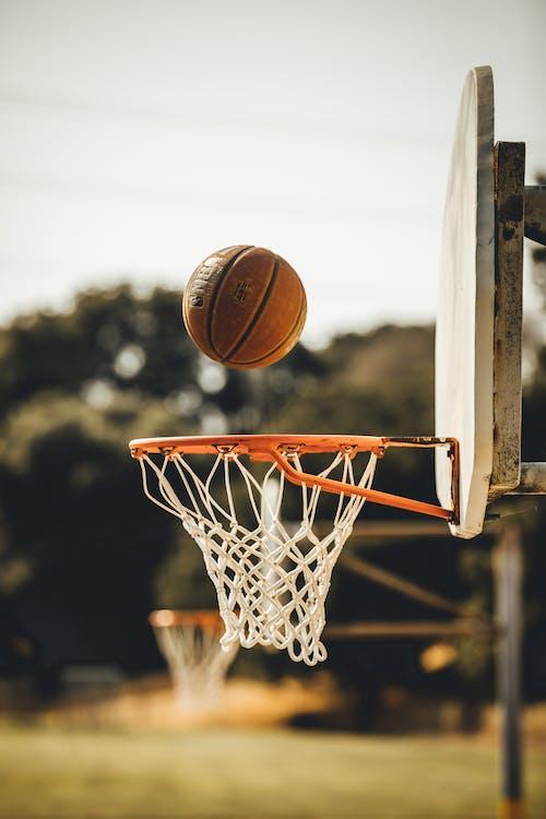 Brown Basketball on Basketball Hoop