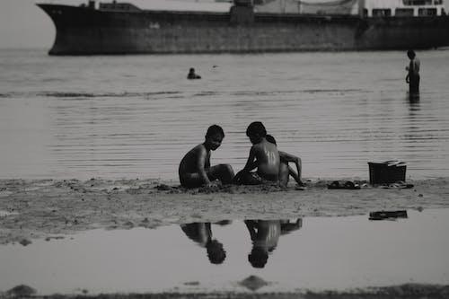 Boys Playing on the Beach