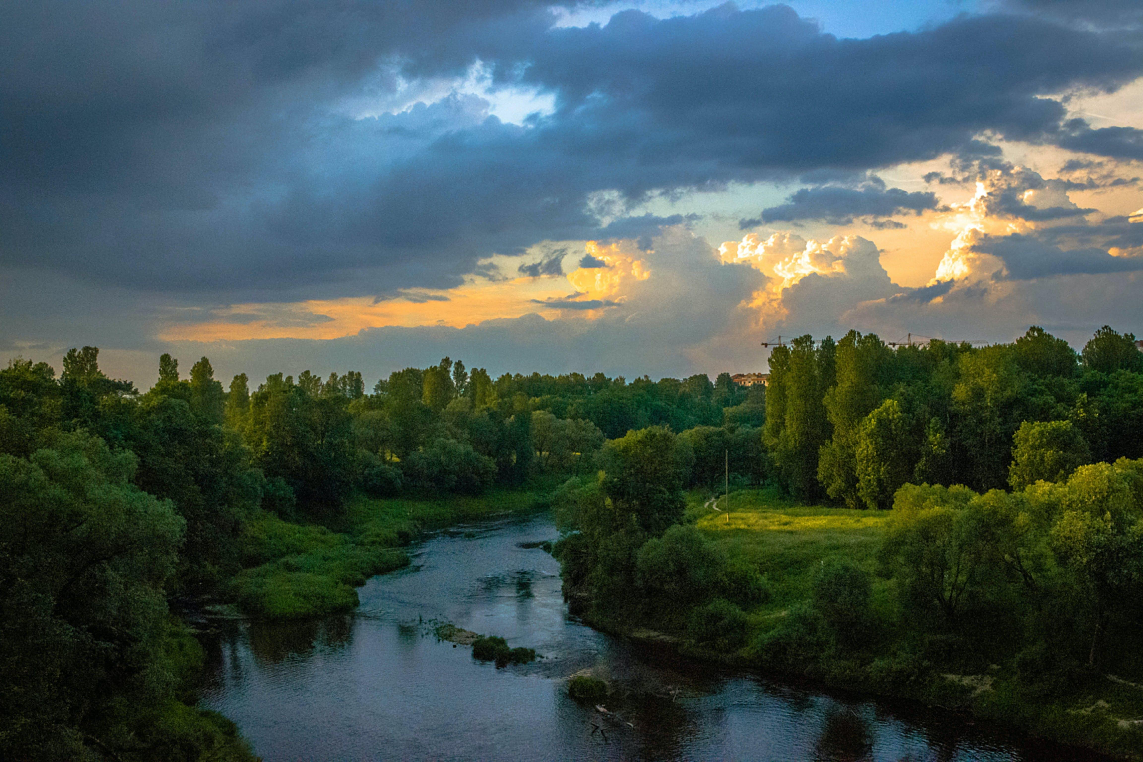 Photo of River Between Green Grass Fields