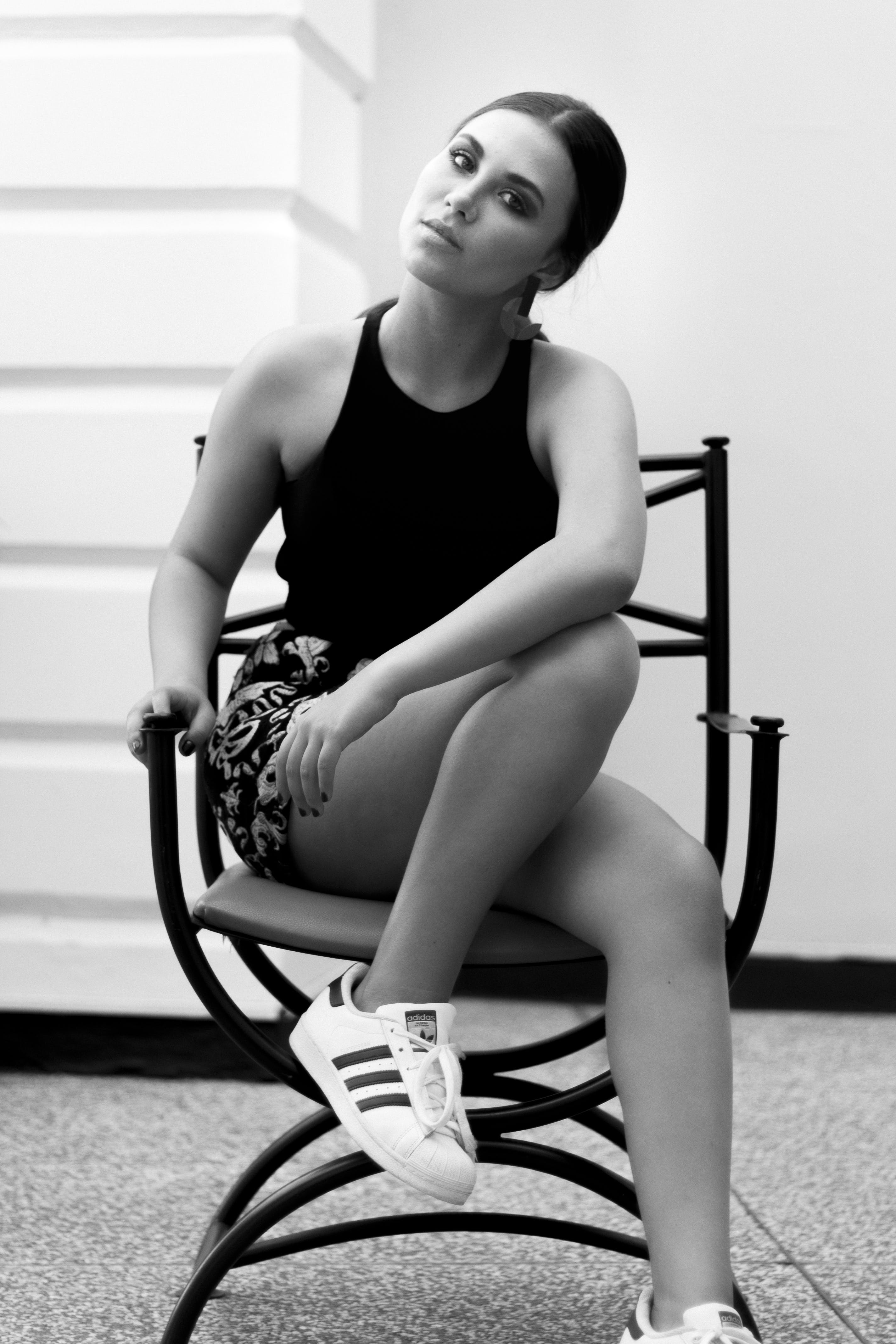 Grayscale Photo of Woman Wearing Sleeveless Tops and Floral Shorts