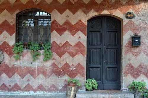 The Black Wooden Door of a House