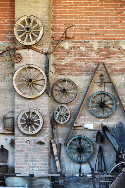 Wooden Wheels on Brick Wall