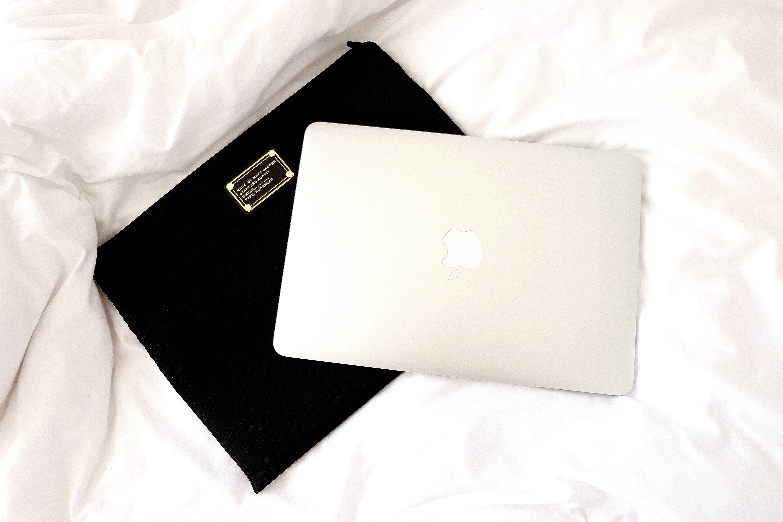 Silver Macbook on Black Case