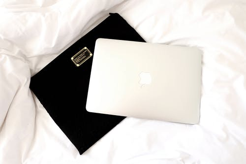 Silver Macbook on Black Case
