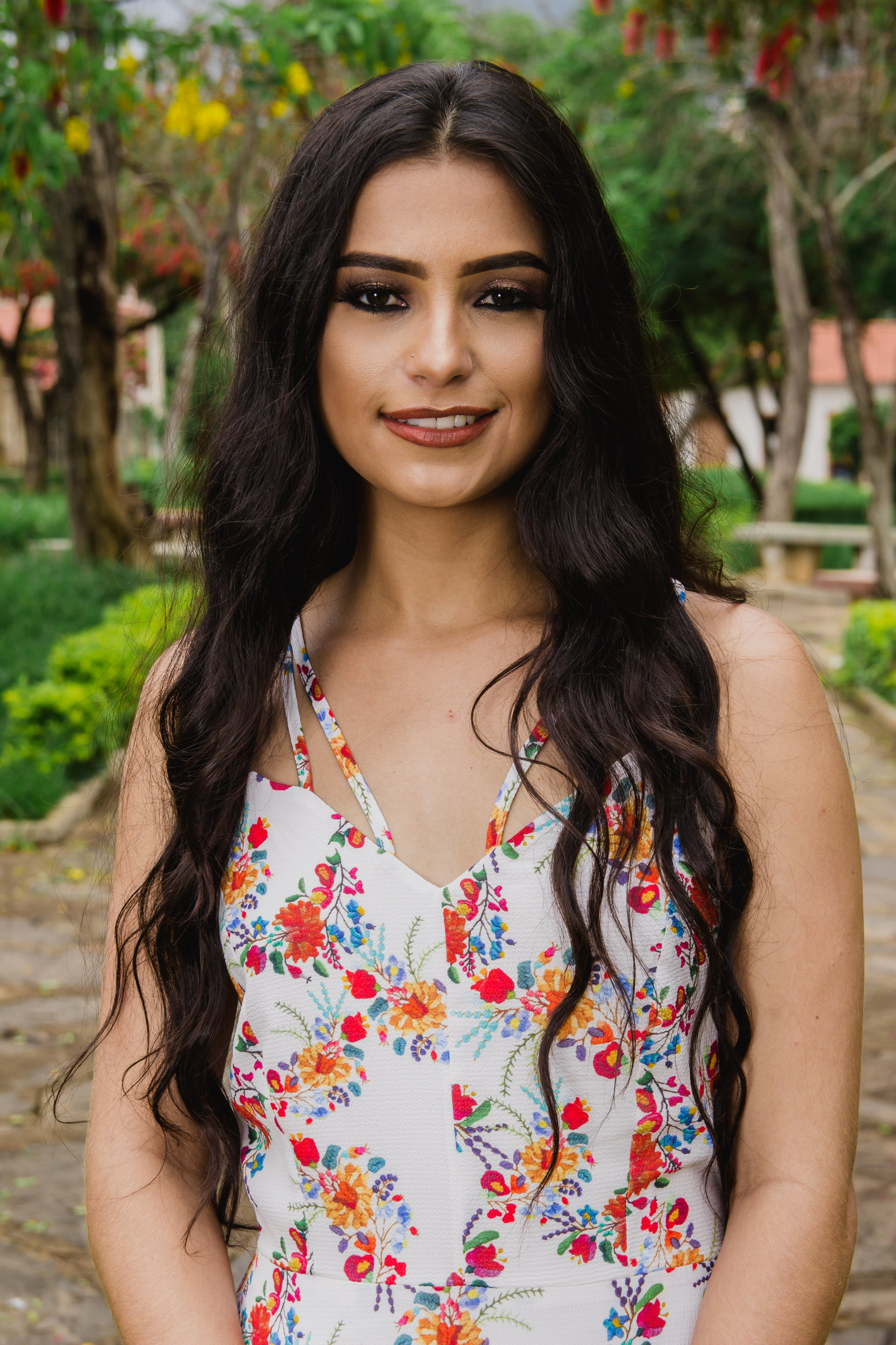 Woman Wearing White and Multicolored Floral Sleeveless Top