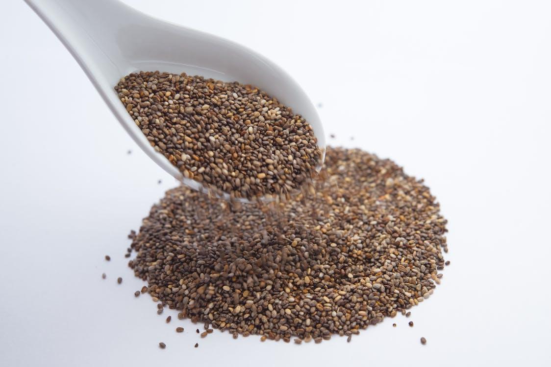 Seeds on White Plastic Spoon