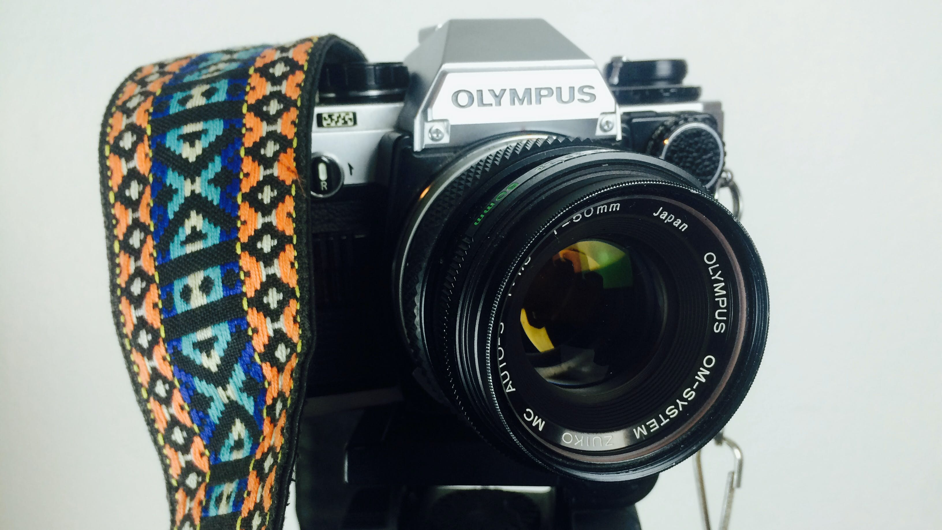 Black and Gray Olympus Dslr Camera White Orange Blue and White Strap