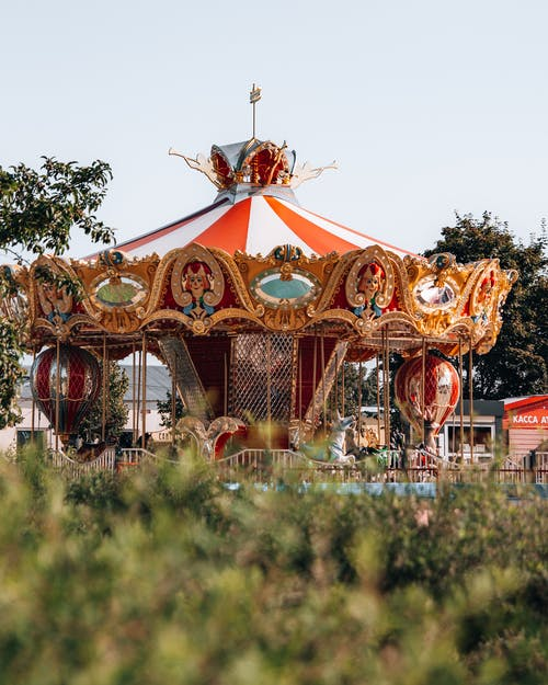 A Carousel Near A Green Field