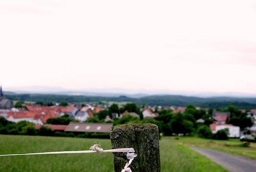 Foto profissional grátis de aldeia, Alemanha, casas, cerca