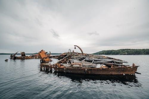 Rusty Broken Boat on the Sea