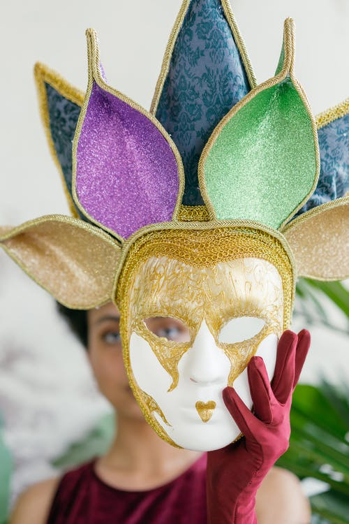 Woman Holding a Mardi Gras Full Face Mask