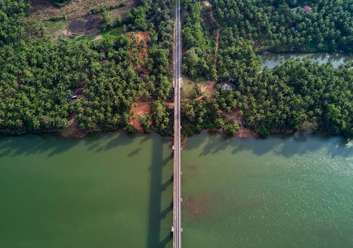 Aerial Photography of Gray Bridge over Body of Water