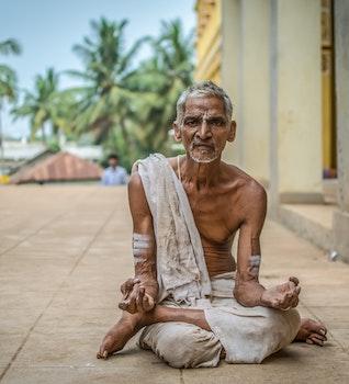 Man Meditating at Daytime