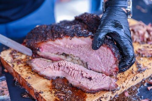 A Person Slicing Barbecue Beef Brisket