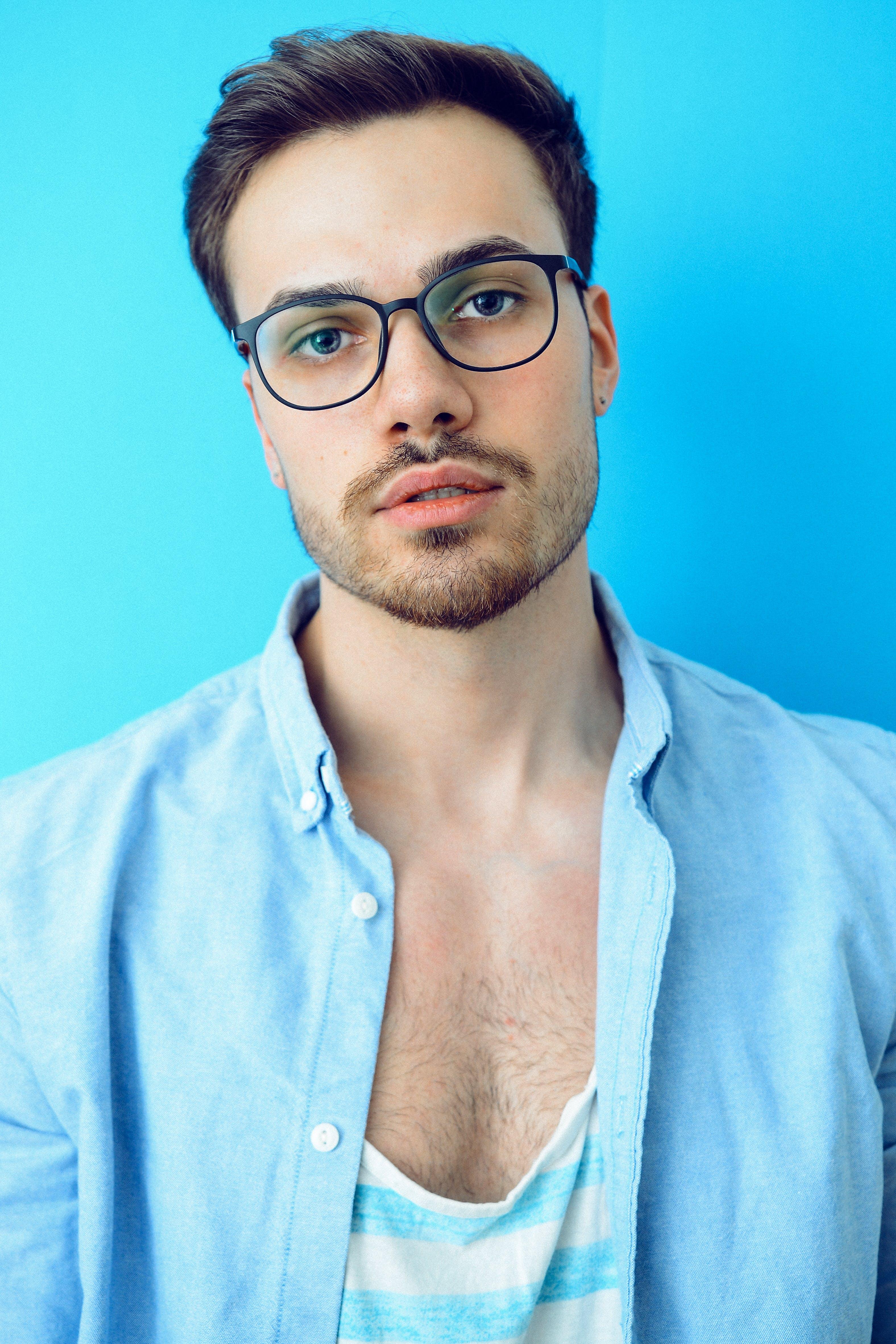 Man in Black Framed Eyeglasses and Blue Button-up Shirt