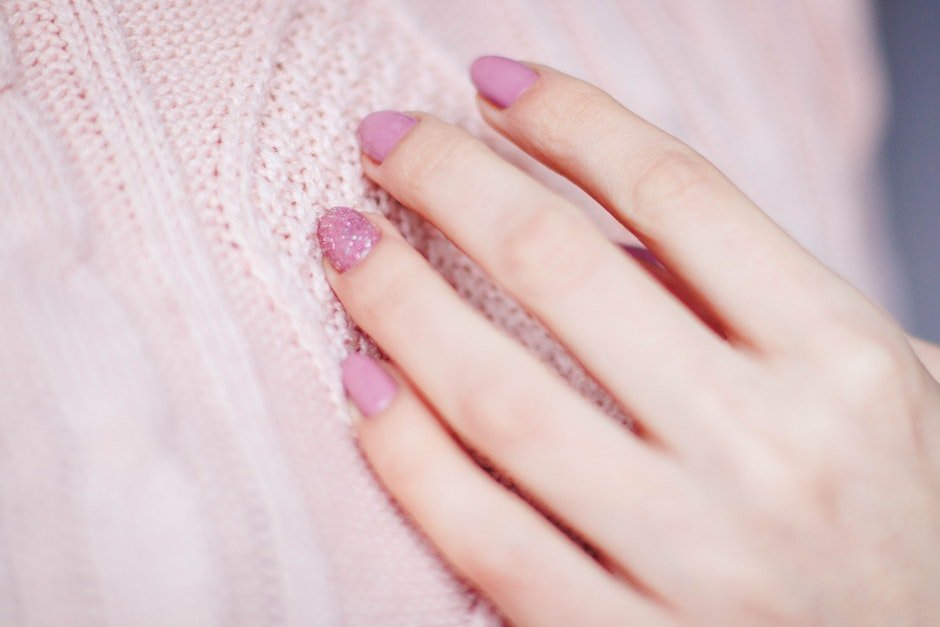 Woman With Pink Manicure