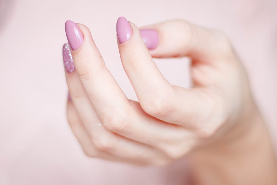 Person's Hand With Pink Manicure