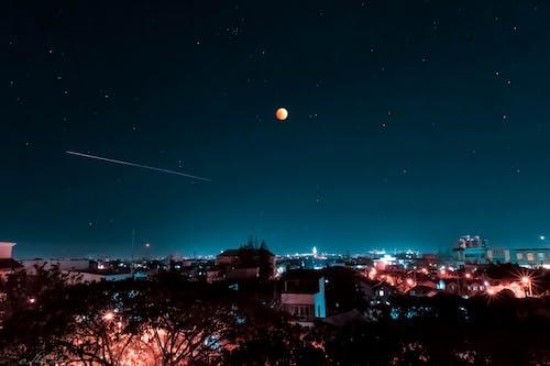 Immagine gratuita di arancia, azzurro, fotografia astronomica, luci della città