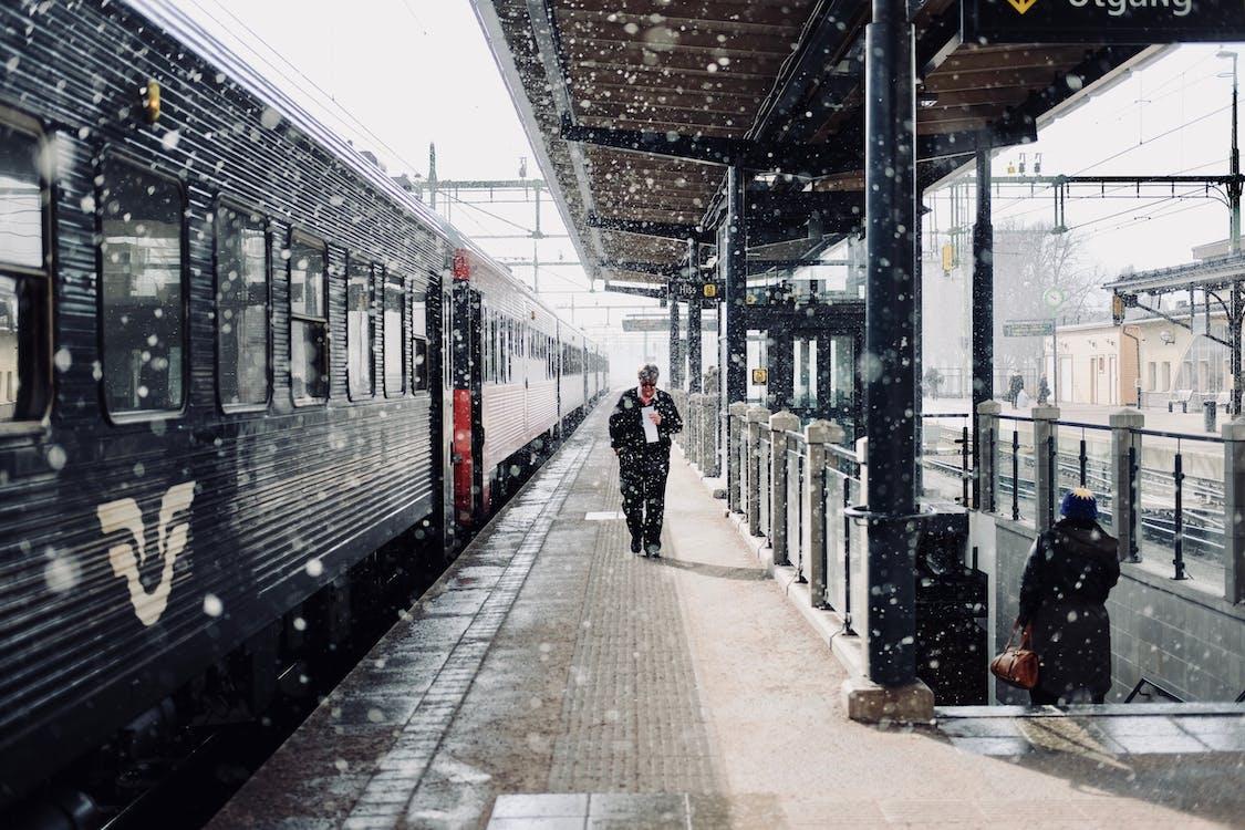 Man Walks Beside Train