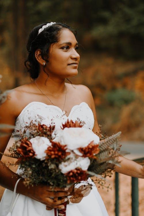 An Elegant Bride Holding a Bridal Bouquet