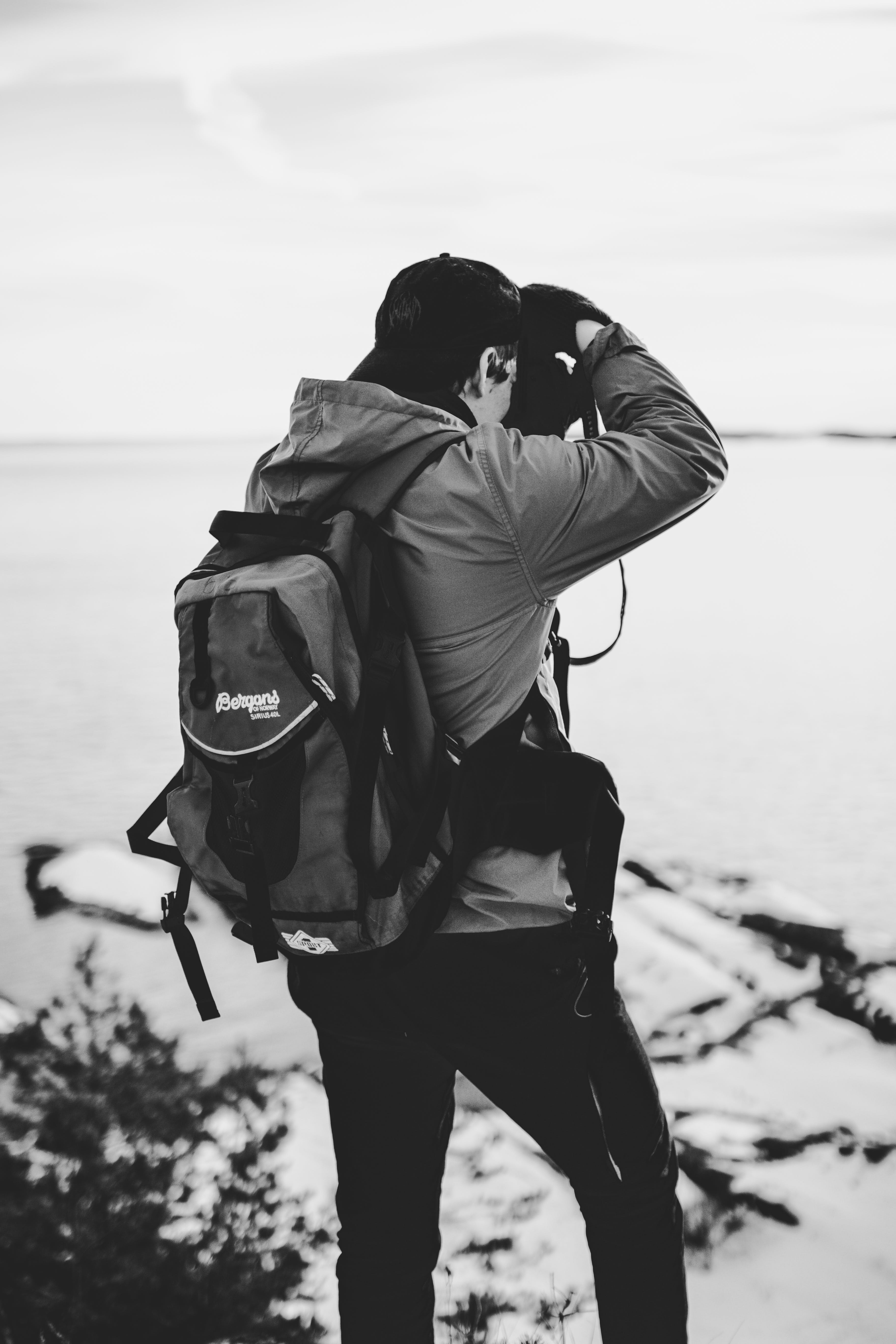 Grayscale Photography of Man Taking Photo