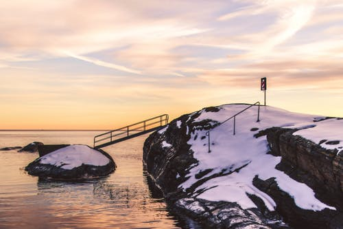 Photo of Cliff With Bridge and Snow