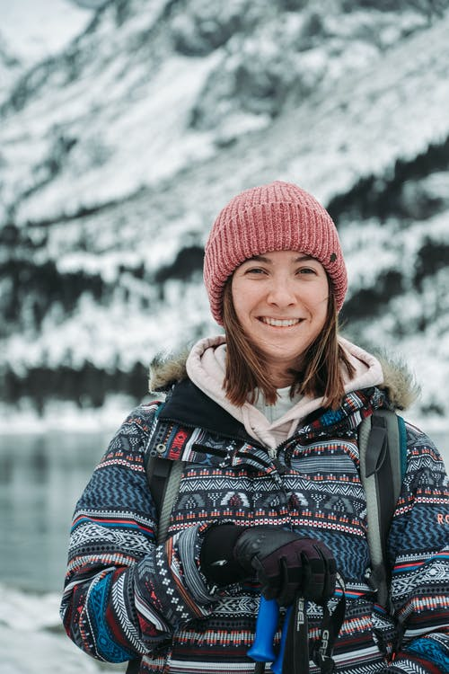 Woman in Red Knit Cap and Blue White and Red Tribal Coat