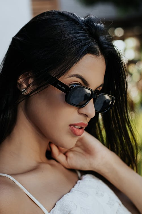 Woman Wearing Black Sunglasses With Black Hair