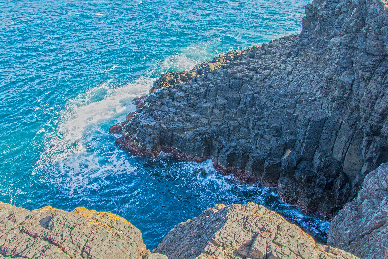 Grey Rock Formation Near Water