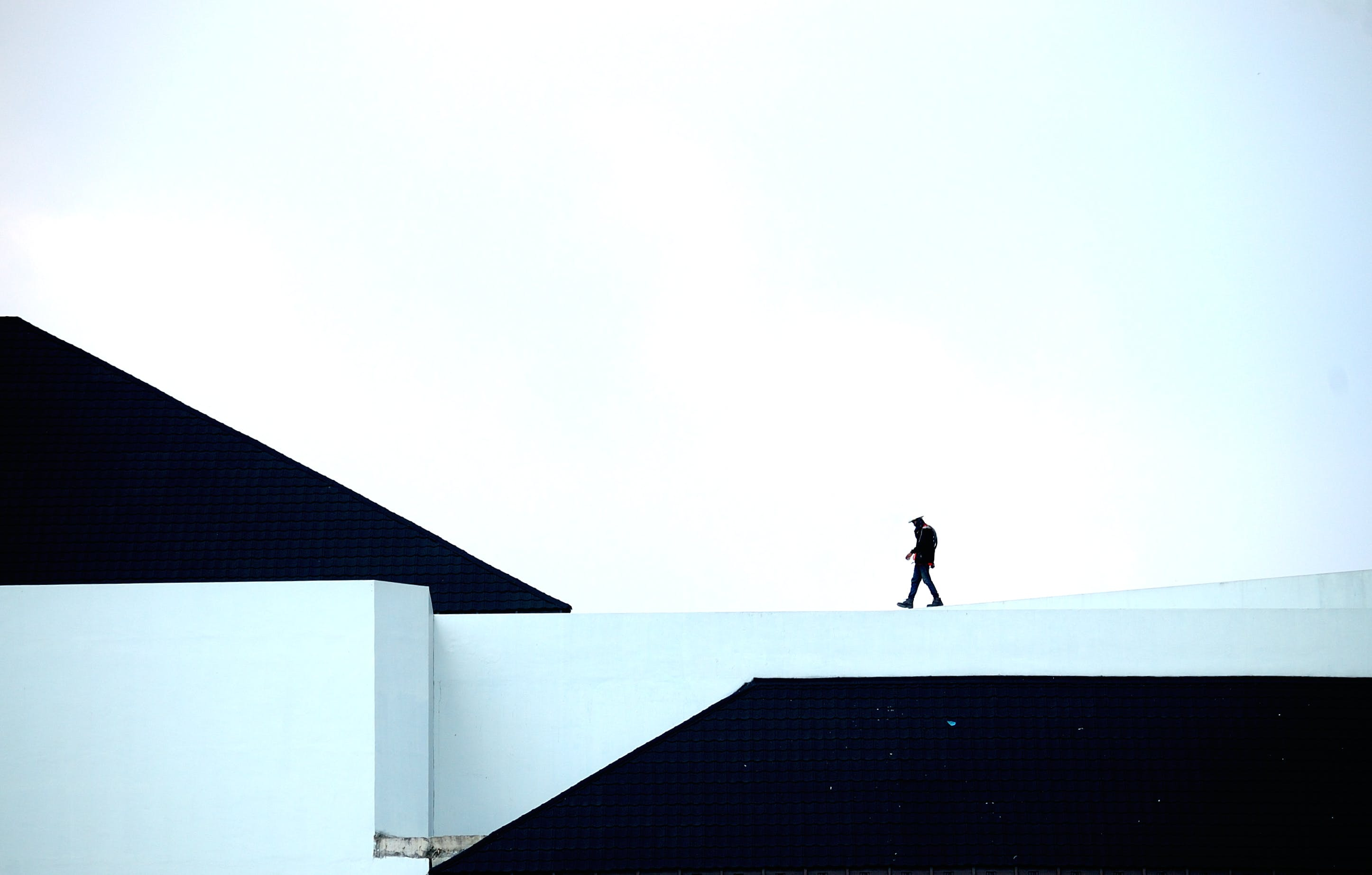 Man Walking on White Platform