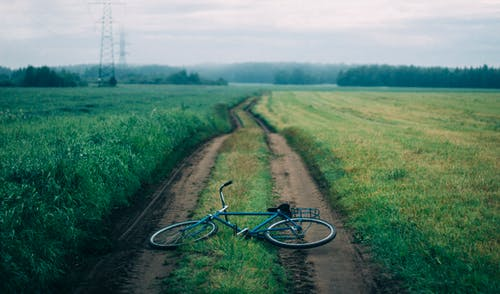 Landscape Photography of Blue Commuter Bike on Green Grass