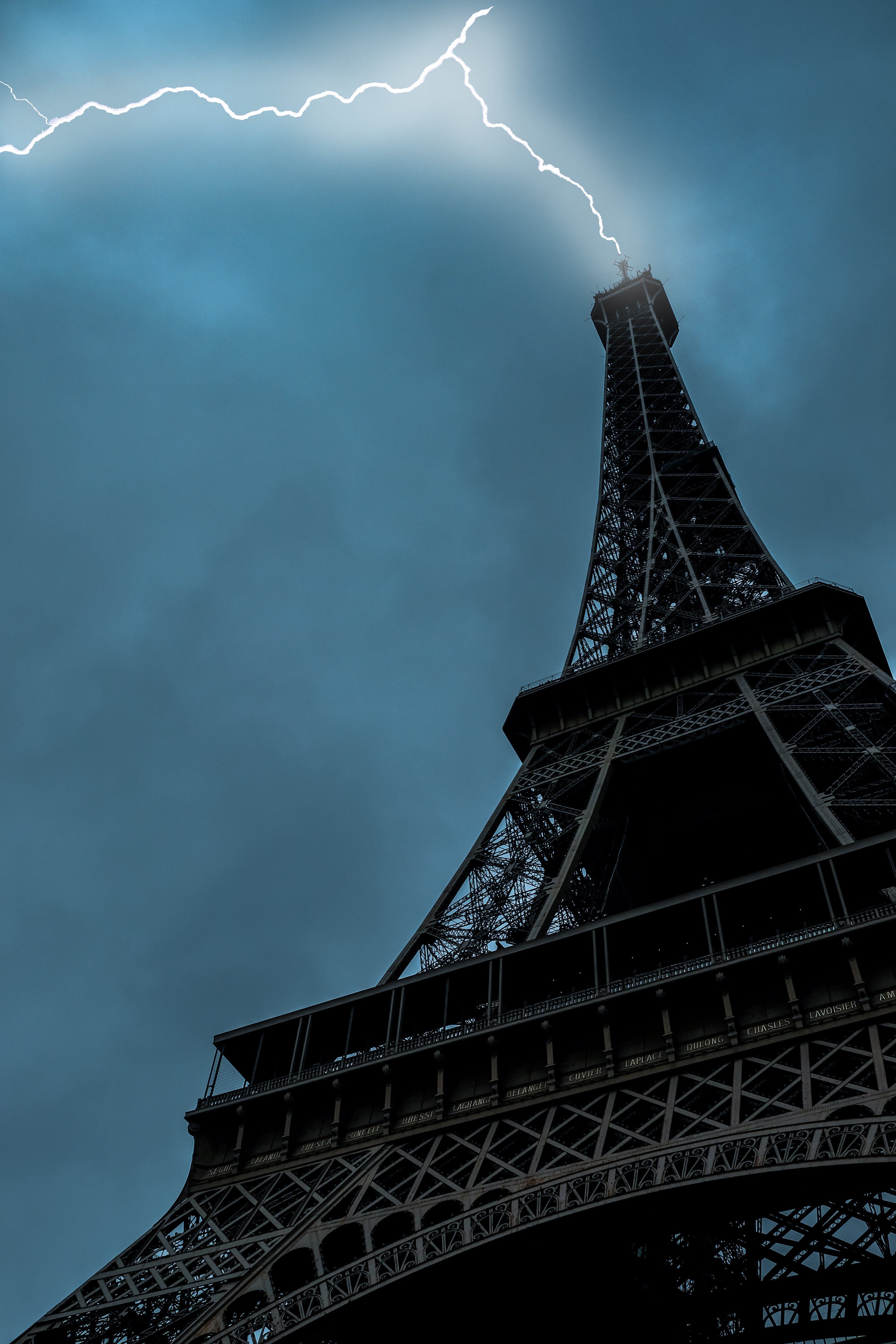 Low-angle Photo of Eiffel Tower Struck by Lightning