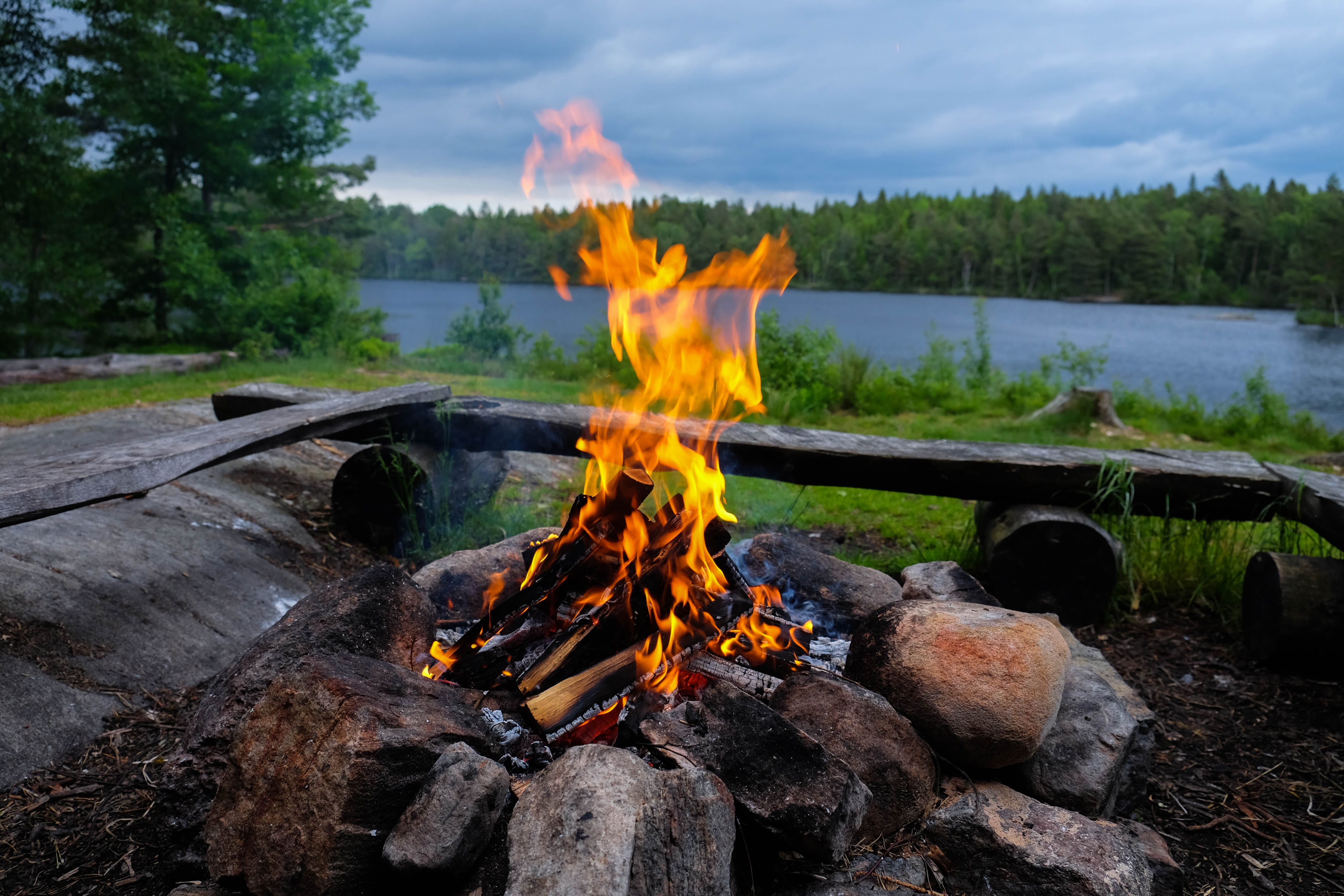 Free stock photo of blue water, camping, cloudy sky, fire
