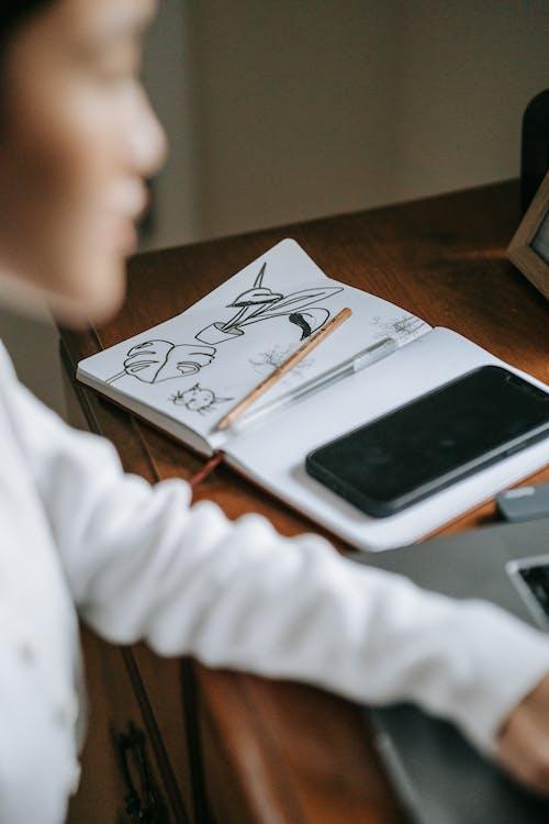 White Smartphone on White Paper