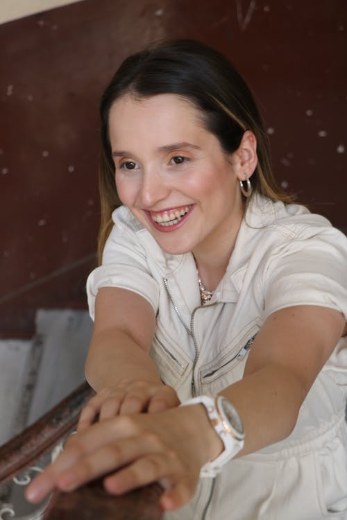 Woman in White Clothing Smiling