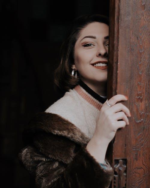 Half Face of Woman in Brown Fur Coat