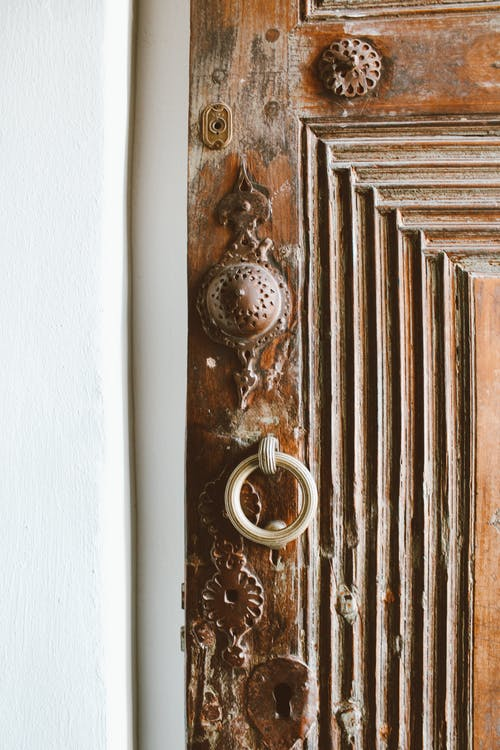 Ring Door Knocker on Brown Wood